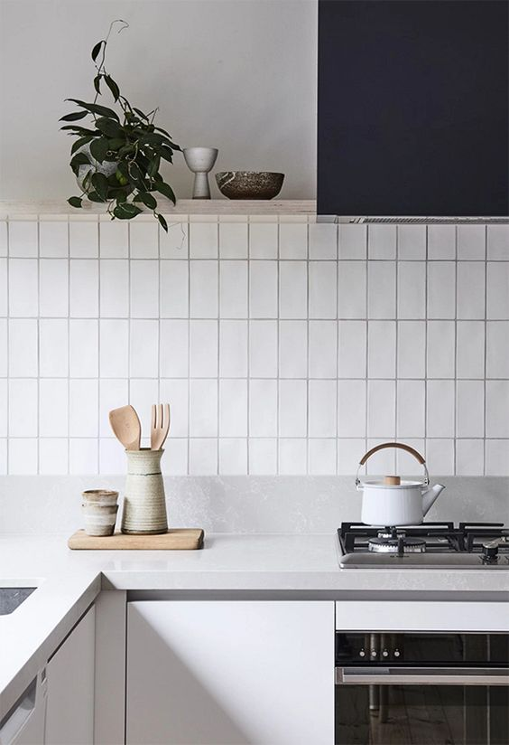 Subway tile patterns stacked vertical in a kitchen | construction2style